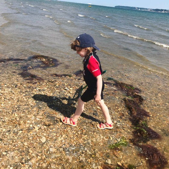 Leaping into the sea at Lepe Beach
